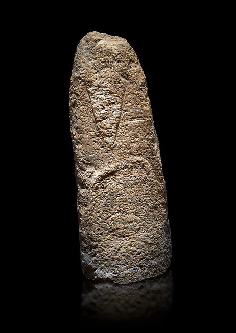 Late European Neolithic prehistoric Menhir standing stone with carvings on its face side. The representation of a stylalised male figure starts at the top with a long nose from which 2 eyebrows arch around the top of the stone. below this is a carving of a falling figure with head at the bottom and 2 curved arms encircling a body above. Excavated from Paule Luturru,  Samugheo. Menhir Museum, Museo della Statuaria Prehistorica in Sardegna, Museum of Prehoistoric Sardinian Statues, Palazzo Aymerich, Laconi, Sardinia, Italy. Black background.
