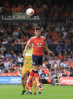Luton Town defender Dan Potts heads the ball away from danger during the Sky Bet League 2 match between Luton Town and Yeovil Town at Kenilworth Road, Luton, England on 13 August 2016. Photo by Liam Smith.
