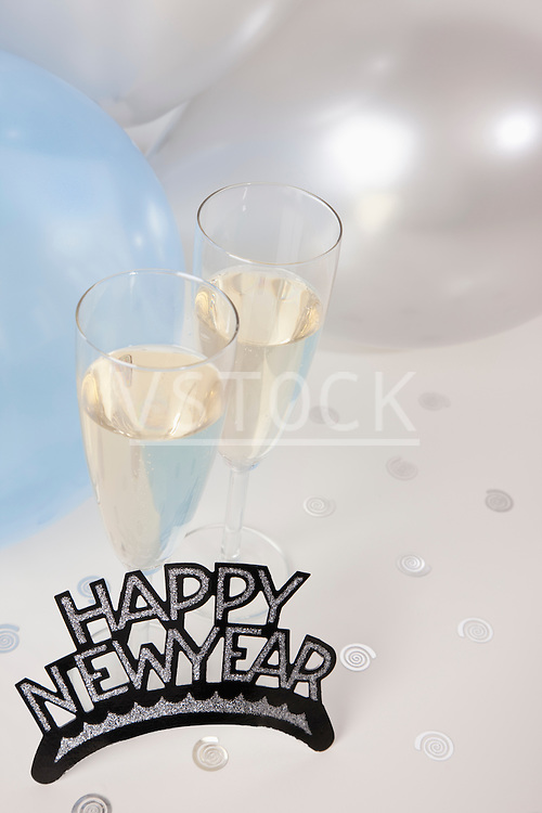 USA, Illinois, Metamora, Champagne flutes with balloons and New Year's Eve decorations