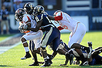 27 November 2010:  FIU cornerback Ashlyn Parker (11) and cornerback Junior Mertile (2) combine to stop Arkansas State wide receiver Dwayne Frampton (9) in the first quarter as the FIU Golden Panthers defeated the Arkansas State Red Wolves, 31-24, at FIU Stadium in Miami, Florida.