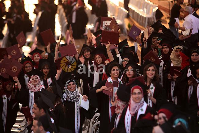 Palestinian students attend their graduation ceremony at the Birzeit University near the West Bank city of Ramallah, June 12, 2015. Photo by Shadi Hatem