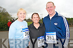 Getting ready for the Currow fun run which saw pupils, parents and teachers take on the 3km challenge last Friday. .L-R Geraldine Ryan and Sinead and Kieran Scanlon.