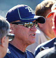 Tampa Bay Rays manager Joe Madden #70 surrounded by media after a spring training game against the Baltimore Orioles at the Charlotte County Sports Park on March 5, 2012 in Port Charlotte, Florida.  (Mike Janes/Four Seam Images)