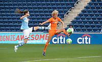 Sky Blue FC defender Daphne Koster (4) and Chicago Red Star forward Kosovare Asllani (10) vie for control of a cross into the box.  The  Chicago Red Stars defeated the Sky Blue FC 2-0 at Toyota Park in Bridgeview, IL on July 10, 2010.