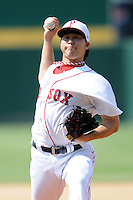 Pawtucket Red Sox pitcher Junichi Tazawa #15 during a game versus the Syracuse Chiefs at McCoy Stadium in Pawtucket, Rhode Island on July 8, 2012.  (Ken Babbitt/Four Seam Images)