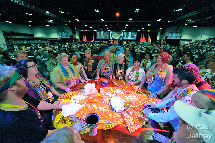 Dozens of demonstrators demanding a more inclusive church took over the floor of a May 3 session of the 2012 United Methodist General Conference in Tampa, Florida. They held communion around the center table and sang songs, causing the presiding bishop to suspend the morning session.
