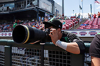 Dayton Dragons infielder Carlos Rivero (4) photographs a pitcher warming up before a Midwest League game against the Cedar Rapids Kernels at Perfect Game Field on May 5, 2019 in Cedar Rapids, Iowa. Cedar Rapids defeated Dayton 4-0. (Zachary Lucy/Four Seam Images)