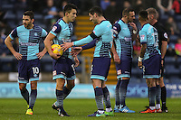 Luke O'Nien of Wycombe Wanderers (2nd left) and Joe Jacobson of Wycombe Wanderers (3rd left) discuss who is to take the free-kick during the Sky Bet League 2 match between Wycombe Wanderers and Morecambe at Adams Park, High Wycombe, England on 12 November 2016. Photo by David Horn.