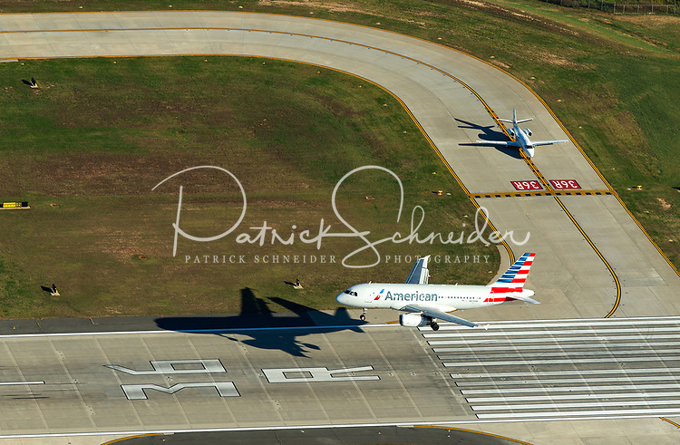 Aerial photography of Charlotte Douglas International Airport, in Charlotte, NC. Charlotte was the 6th busiest airport in the world, based on traffic movements, and it was the 23rd busiest airport in the world by passenger traffic.<br /> <br /> Charlotte Photographer - PatrickSchneiderPhoto.com