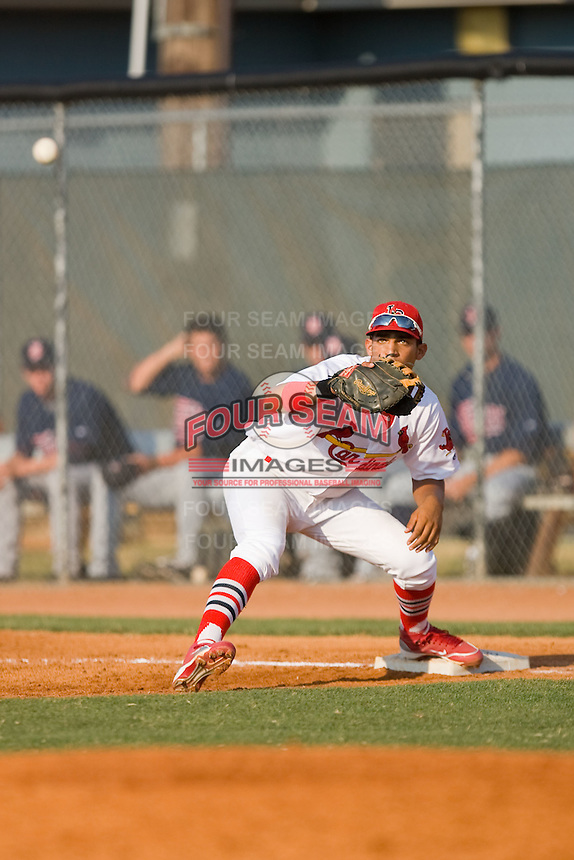 First baseman David Medina #22 of the Johnson City Cardinals stretches for a throw against the Elizabethton Twins at Howard Johnson Field July 3, 2010, in Johnson City, Tennessee.  Photo by Brian Westerholt / Four Seam Images