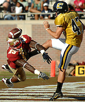 Florida State #23 Roosevelt Lawson (left) flyies in to block the punt of Chattanooga's #47 Jeff Lloyd with the ball going through the endzone for a safety at Doak Campbell Stadium in Tallahassee, Fl. (The Florida Times-Union, Rick Wilson)