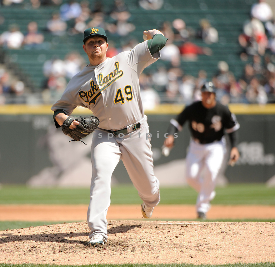 BRETT ANDERSON, of the Oakland A's, in action during the A's game against the Chicago White Sox on April 13, 2011 at US Cellular Field in Chicago, Illinois.  The Oakland A's beat the Chicago White Sox 7-4.