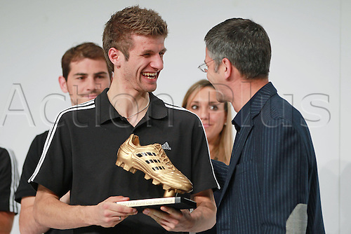14.12.2010 The FIFA 2010 World Cup adidas Golden Award ceremony at the adidas headquarters in Herzogenaurach, Germany. Picture shows Manager the Year Herbert Hainer handing Thomas Mueller the Golden Boot award.