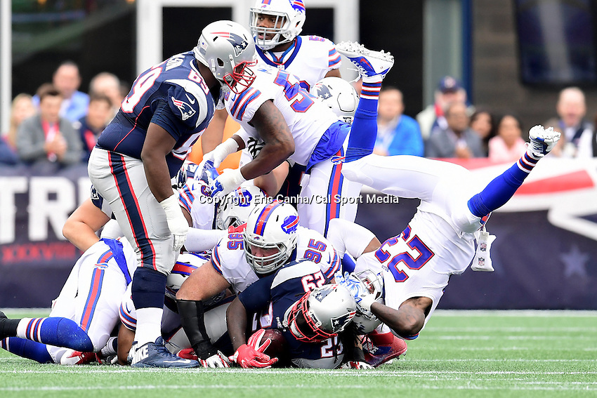 Sunday, October 2, 2016: New England Patriots running back LeGarrette Blount (29) is tackled by Buffalo Bills defensive end Kyle Williams (95) and strong safety Aaron Williams (23) during the NFL game between the Buffalo Bills and the New England Patriots held at Gillette Stadium in Foxborough Massachusetts. Buffalo defeats New England 16-0. Eric Canha/Cal Sport Media