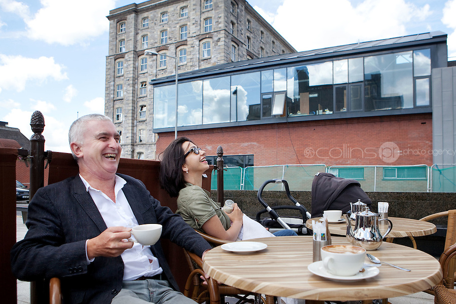 28/6/2011. Danielle Ryan and baby Ethan are pictured with Joe Kennedy managing director of Smith Kennedy Architects at a coffee shop outside the building of the National Academy of Dramatic Art - The Lir - in Dublin, Ireland. Picture James Horan/Collins Photos
