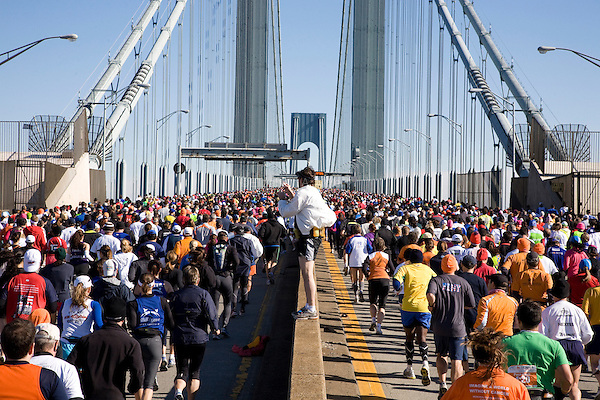 A runner stops to take a picture as runners from Wave Three cross the Verrazano-Narrows Bridge at the start of the ING New York City Marathon on Staten Island on 07 November 2010.