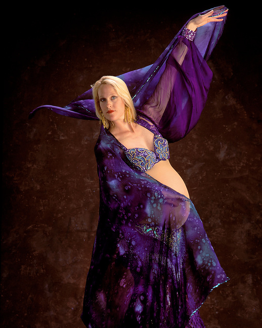 PREGNANT BELLY DANCER IN BLUE.