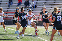 College Park, MD - April 27, 2019: Maryland Terrapins midfielder Jen Giles (5) attempts a shot during the game between John Hopkins and Maryland at  Capital One Field at Maryland Stadium in College Park, MD.  (Photo by Elliott Brown/Media Images International)