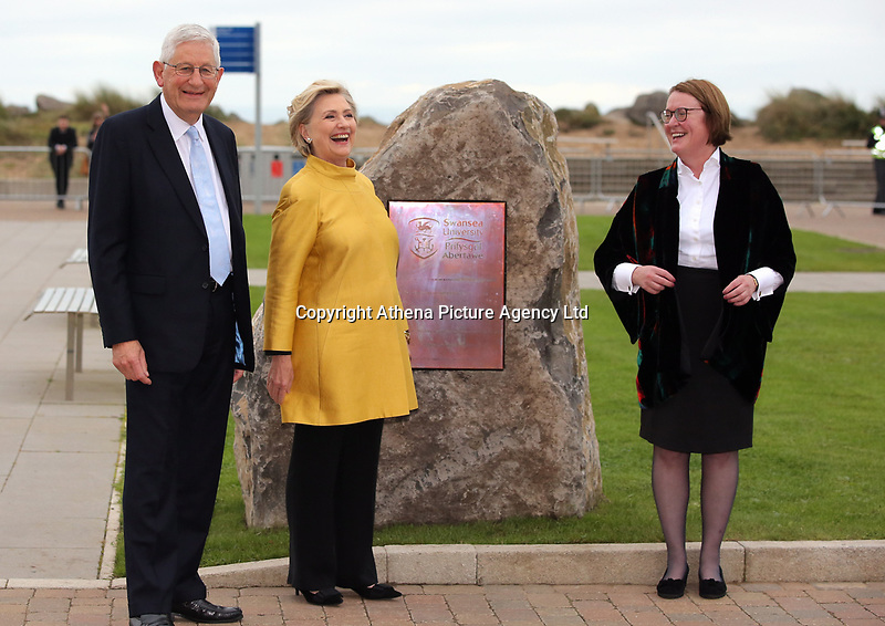 Pictured L-R: Professor Richard B Davies, Vice Chancellor of Swansea University, Hillary Clinton and Professor Elwen Evans QC, unveil a commemorative plaque on a rock at Swansea University Bay Campus. Saturday 14 October 2017<br /> Re: Hillary Clinton, the former US secretary of state and 2016 American presidential candidate will be presented with an honorary doctorate during a ceremony at Swansea University's Bay Campus in Wales, UK, to recognise her commitment to promoting the rights of families and children around the world.<br /> Mrs Clinton's great grandparents were from south Wales.