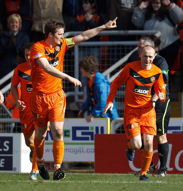 Jon Daly celebrates his goal for Dundee Utd