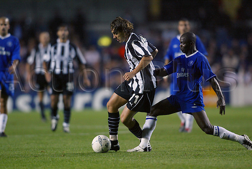 October 01, 2003: BESIKTAS player OKAN KOC shields the ball from Claude Makelele during the UEFA Champions League Group G game at Stamford Bridge. Chelsea 0 v Besiktas 2 Photo: Glyn Kirk/action plus..soccer football 031001 player