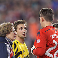 After being ejected Ethan Finlay apologizes to Bobby Shuttleworth. Foxborough, Massachusetts - November 9, 2014: In Major League Soccer (MLS) Eastern Conference aggregate goal semifinal, the New England Revolution (blue/white) defeated Columbus Crew (yellow), 3-1, at Gillette Stadium and advance to the Eastern Conference finals with aggregate goals of 7-3 (4-2 and 3-1).