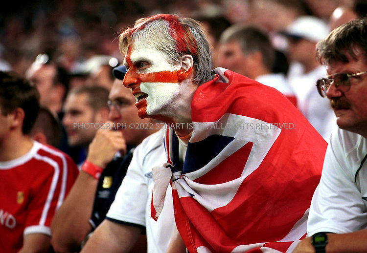 6/2/2002--Saitama, Japan..England Vs. Sweden. An England fan jeers Sweden moments after Sweden scored the equaliser after 59 minutes when Niclas Alexandersson took advantage of a terrible error by Danny Mills.  Sunday's match. Despite fears in Japan of hooliganism the game went off witout a single arrest and word of trouble. Sweden produced a determined second-half display to hold England to a 1-1 draw in their opening World Cup Group F match on Sunday, maintaining a jinx going back to 1968...All photographs ©2003 Stuart Isett.All rights reserved.This image may not be reproduced without expressed written permission from Stuart Isett.