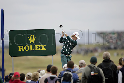 15 July 2004: Rear view of Australian golfer Aaron Baddeley (AUS) driving from the 6th tee during the first round of The Open Championship played at Royal Troon, Scotland. Photo: Glyn Kirk/Action Plus...golf wood drive driver  040715.British