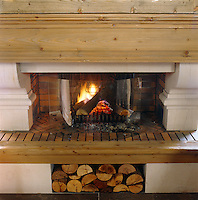 The stone fireplace in the cosy living room is in keeping with the contemporary design of the chalet