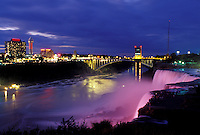 Niagara Falls, Canada/USA, Ontario, NY, New York, Niagara River, Illumination at the American Falls at Niagara Falls at night.