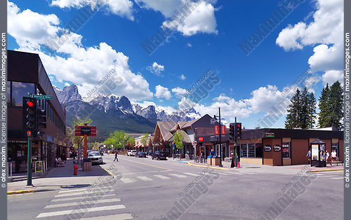 Springtime downtown city scenery of Canmore, town in Alberta Rockies, Bow valley with mountains in the background. Canmore, Alberta, Canada.