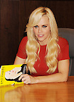 LOS ANGELES, CA - OCTOBER 08: Jenny McCarthy signs copies of her new book 'Bad Habits' at Barnes & Noble bookstore at The Grove on October 8, 2012 in Los Angeles, California.