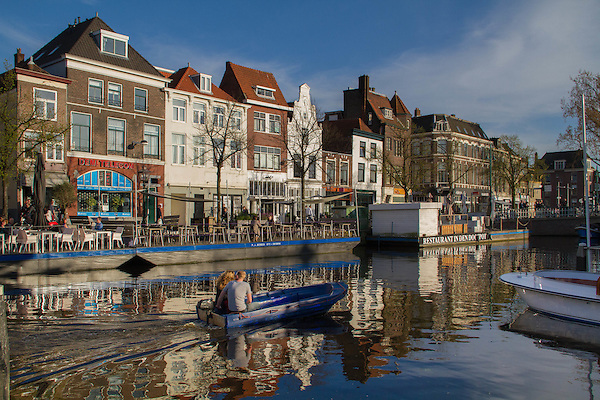 Boater on a canal in Leiden, Holland, the Netherlands,