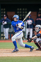 Sal Annunziata (11) of the Seton Hall Pirates follows through on his swing against the Virginia Cavaliers at The Ripken Experience on February 28, 2015 in Myrtle Beach, South Carolina.  The Cavaliers defeated the Pirates 4-1.  (Brian Westerholt/Four Seam Images)