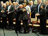 "United States President Barack Obama (3rd L) hugs NASA astronaut Mark Kelly (3rd R), husband of U.S. Representative Gabrielle Giffords (Democrat of Arizona), as he arrives to attend the event ""Together We Thrive: Tucson and America"" honoring the January 8 shooting victims at McKale Memorial Center on the University of Arizona campus on Wednesday, January 12, 2011 in Tucson, Arizona. The memorial service is in honor of victims of the mass shooting at a Safeway grocery store that killed six and injured at least 13 others, including U.S. Representative Gabrielle Giffords (Democrat of Arizona), who remains in critical condition after being shot in the head. Among those killed were U.S. District Judge John Roll, 63; Giffords' director of community outreach, Gabe Zimmerman, 30; and 9-year-old Christina Taylor Green. .Credit: Kevork Djansezian / Pool via CNP"