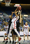 Liberty's Rae Burrell shoots past McQueen defenders Alisi Peaua and Kendra McAninch during the NIAA state basketball tournament in Reno, Nev., on Thursday, Feb. 22, 2018. Liberty defeated McQueen 71-33. Cathleen Allison/Las Vegas Review-Journal