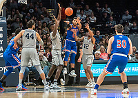 WASHINGTON, DC - DECEMBER 28: Sa'eed Nelson #0 of American throws out a pass. during a game between American University and Georgetown University at Capital One Arena on December 28, 2019 in Washington, DC.