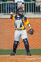 Canisius Golden Griffins catcher Christ Conley (13) throws the ball back to his pitcher during the game against the Charlotte 49ers at Hayes Stadium on February 23, 2014 in Charlotte, North Carolina.  The Golden Griffins defeated the 49ers 10-1.  (Brian Westerholt/Four Seam Images)
