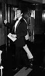 Roger Moore Attending Friars Club Roast at the waldorf Astoria Hotel, New York City. May 1983