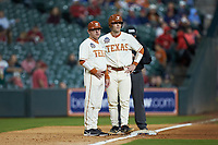Texas Longhorns head coach David Pierce chats with DJ Petrinsky (6) as he stands on third base during the game against the Arkansas Razorbacks in game six of the 2020 Shriners Hospitals for Children College Classic at Minute Maid Park on February 28, 2020 in Houston, Texas. The Longhorns defeated the Razorbacks 8-7. (Brian Westerholt/Four Seam Images)