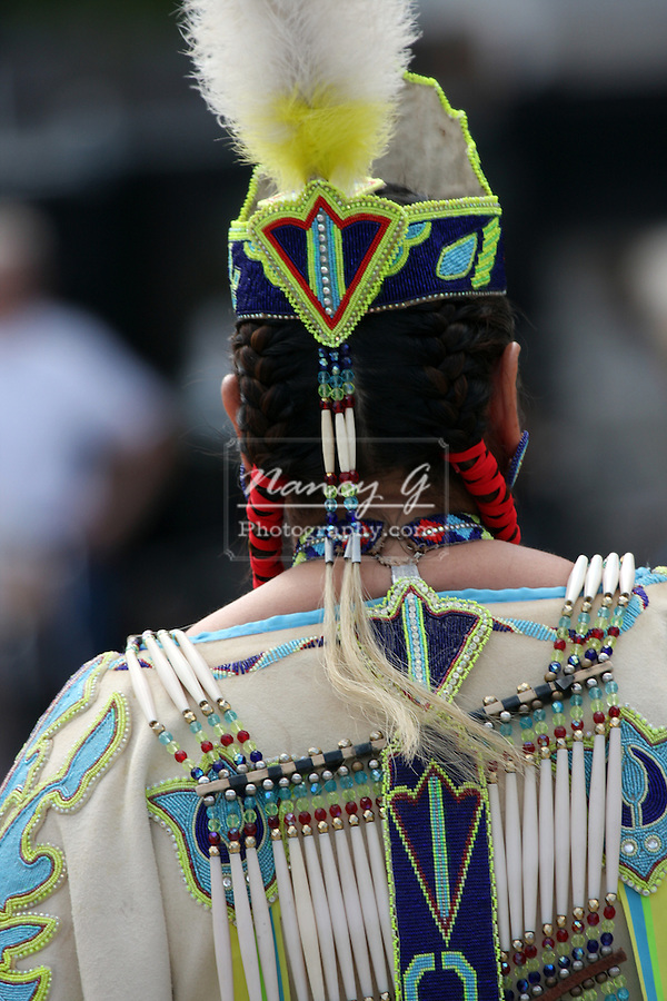 A Native American Indian women in a fancy dancing dress at a Pow Wow at the Milwaukee Lakefront Indian Summer Festival, Wisconsin