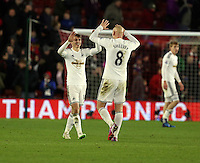 Pictured: Jonjo Shelvey of Swansea celebratingf his team's win with team mate Tom Carroll at the end of the game Sunday 01 February 2015<br /> Re: Premier League Southampton v Swansea City FC at ST Mary's Ground, Southampton, UK.
