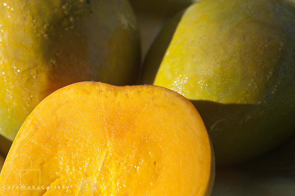 Graham mangos close up with one cut in half