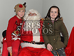 Aoife Leonard and Grace Conway who met Santa at the Dunleer Christmas Fair in the Market House. Photo:Colin Bell/pressphotos.ie