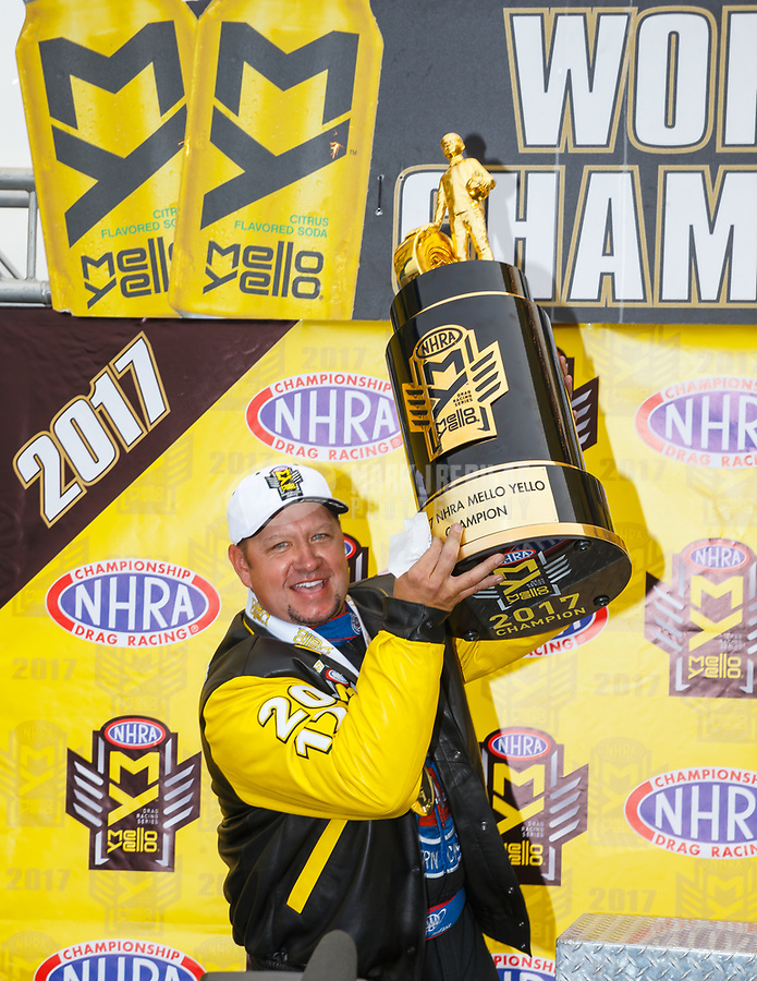 Nov 12, 2017; Pomona, CA, USA; NHRA funny car driver Robert Hight celebrates after clinching the 2017 NHRA funny car world championship during the Auto Club Finals at Auto Club Raceway at Pomona. Mandatory Credit: Mark J. Rebilas-USA TODAY Sports
