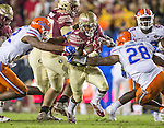 Florida defensive lineman Jabari Zuniga, (92) and linebacker Kylan Johnson close in on Florida State running back Dalvin Cook in the second half of an NCAA college football game in Tallahassee, Fla., Saturday, Nov. 26, 2016. Florida State defeated Florida 31-13. (AP Photo/Mark Wallheiser)