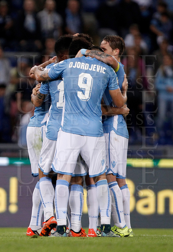 Calcio, Serie A: Lazio vs Frosinone. Roma, stadio Olimpico, 4 ottobre 2015.<br /> Lazio&rsquo;s Filip Djordjevic, center, back to camera, celebrates with teammates after scoring during the Italian Serie A football match between Lazio and Frosinone at Rome's Olympic stadium, 4 October 2015.<br /> UPDATE IMAGES PRESS/Isabella Bonotto
