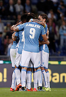 Calcio, Serie A: Lazio vs Frosinone. Roma, stadio Olimpico, 4 ottobre 2015.<br /> Lazio's Filip Djordjevic, center, back to camera, celebrates with teammates after scoring during the Italian Serie A football match between Lazio and Frosinone at Rome's Olympic stadium, 4 October 2015.<br /> UPDATE IMAGES PRESS/Isabella Bonotto