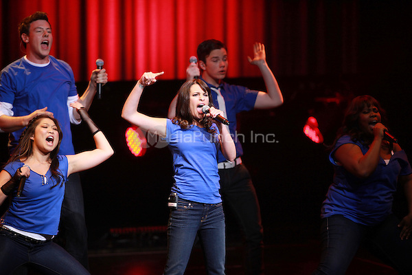 Jenna Ushkowitz, Cory Monteith, Lea Michele, Chris Colfer and Amber Riley performing at the Glee Concert Tour. The Gibson Amphitheatre at Universal City Walk in Los Angeles, California. May 20, 2010.Credit: Dennis Van Tine/MediaPunch