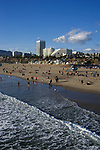View of Santa Monica beach and downtown from the pier in Los Angeles, CA